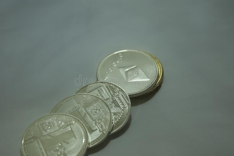 Collection of silver and gold cryptocurrency coins on a white background royalty free stock images