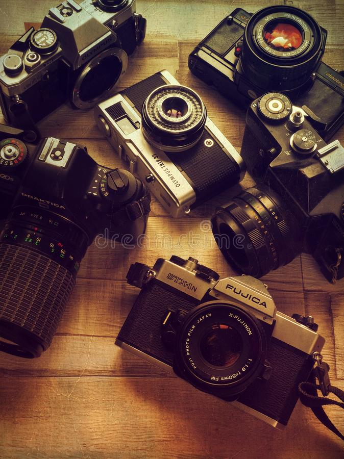 Collection of six vintage 35mm film cameras in black and silver royalty free stock images