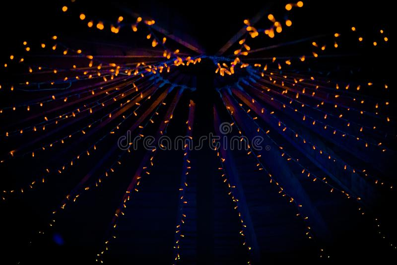 A collection of small little orange lights at a wedding royalty free stock photos