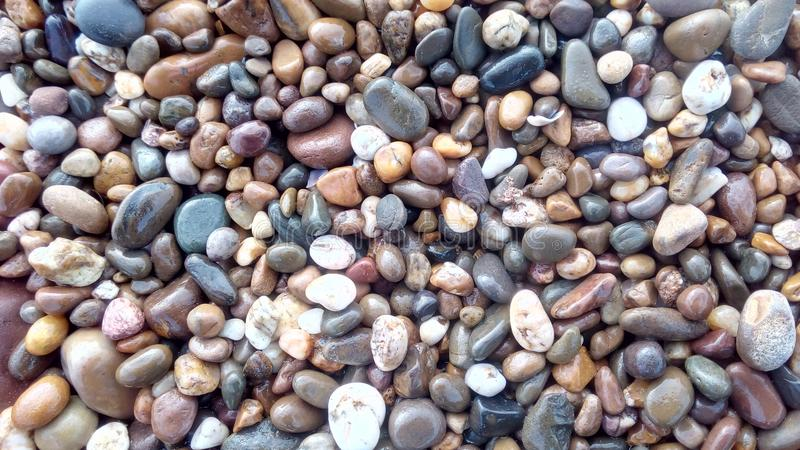Stones beach natural pattern from morocco africa. Collection of smooth stones wallpaper background sea beach sand morocco travel natural pattern royalty free stock photo