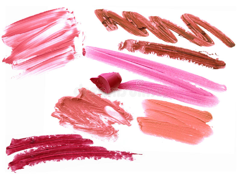 Collection of smudged lipsticks isolated on white. Collection of smudged lipsticks isolated on white royalty free stock image