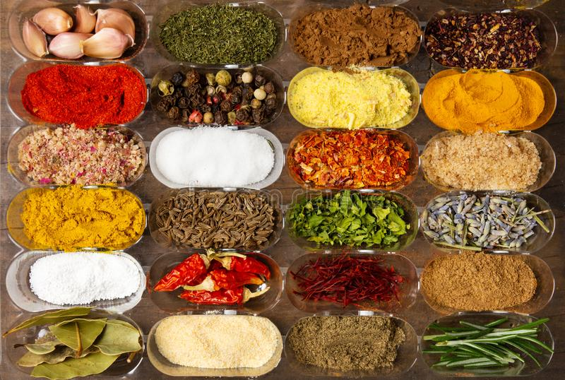 Collection of spices in small bowls royalty free stock image