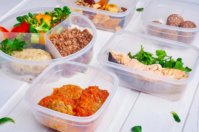 Collection of take away foil boxes with healthy food. Set of containers with everyday meals stock images