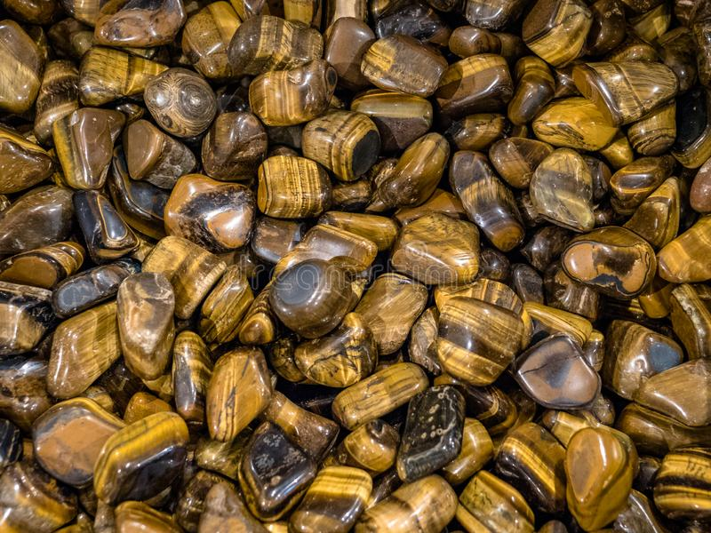 Collection of tigers eye semi precious stones and minerals. stock photography
