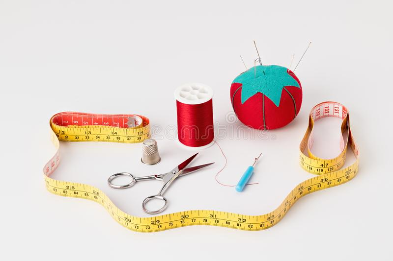 Collection of tools used to sew items at home. Sewing tools used in the making of a shirt royalty free stock image
