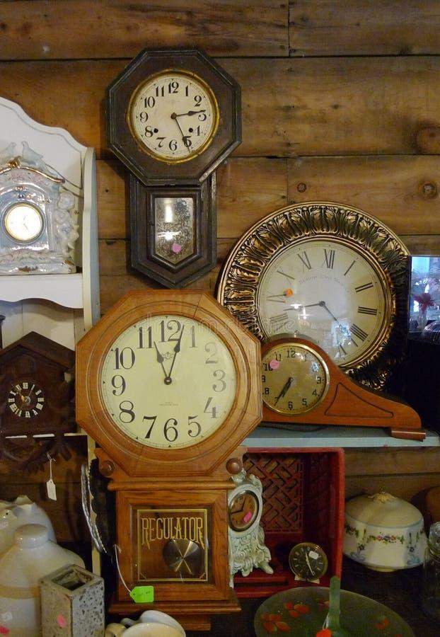 Antique clocks, wall clocks, mantel clocks, collection stock photos