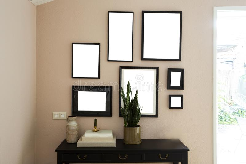 Collection of various blank black frames on wall with modern decoration, green plant in a lovely home royalty free stock photography