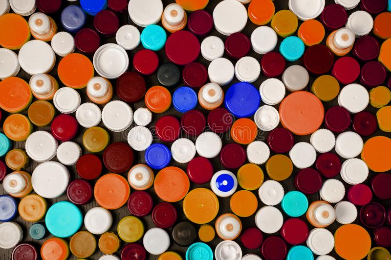 Collection of various colorful plastic caps. Conception of plastic processing for ecology or charity. Collection of various colorful plastic caps. Useful as royalty free stock image