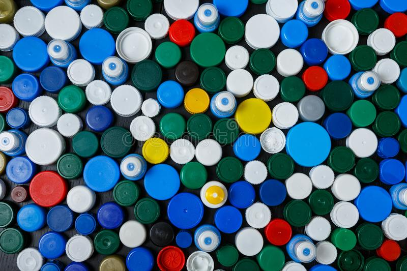 Collection of various colorful plastic caps. Conception of plastic processing for ecology or charity. Collection of various colorful plastic caps. Useful as stock images