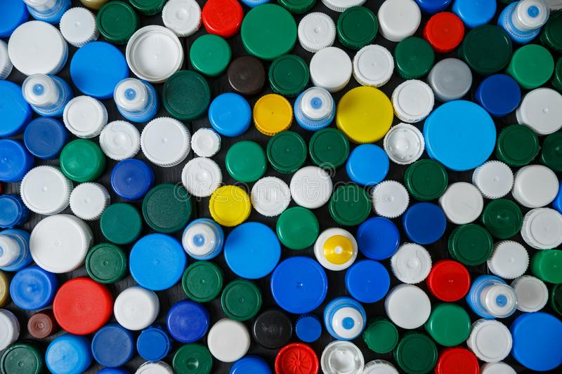 Collection of various colorful plastic caps. Conception of plastic processing for ecology or charity. Collection of various colorful plastic caps. Useful as stock image
