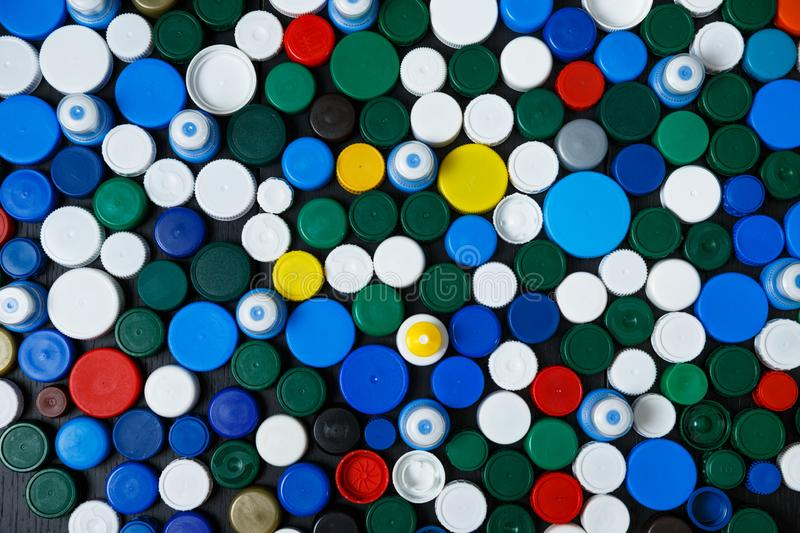Collection of various colorful plastic caps. Conception of plastic processing for ecology or charity. Collection of various colorful plastic caps. Useful as royalty free stock photography