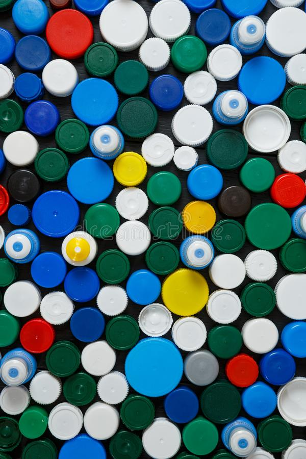 Collection of various colorful plastic caps. Conception of plastic processing for ecology or charity. Collection of various colorful plastic caps. Useful as royalty free stock photo