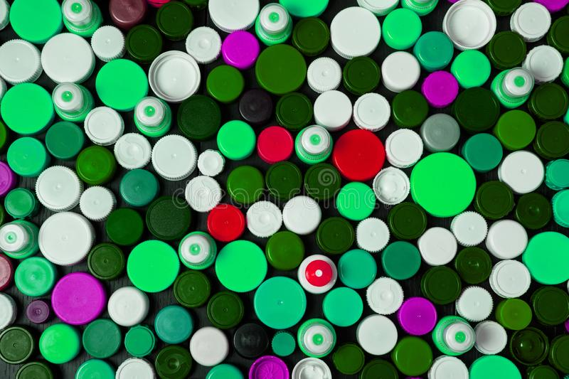 Collection of various colorful plastic caps. Conception of plastic processing for ecology or charity. Collection of various colorful plastic caps. Useful as royalty free stock photos