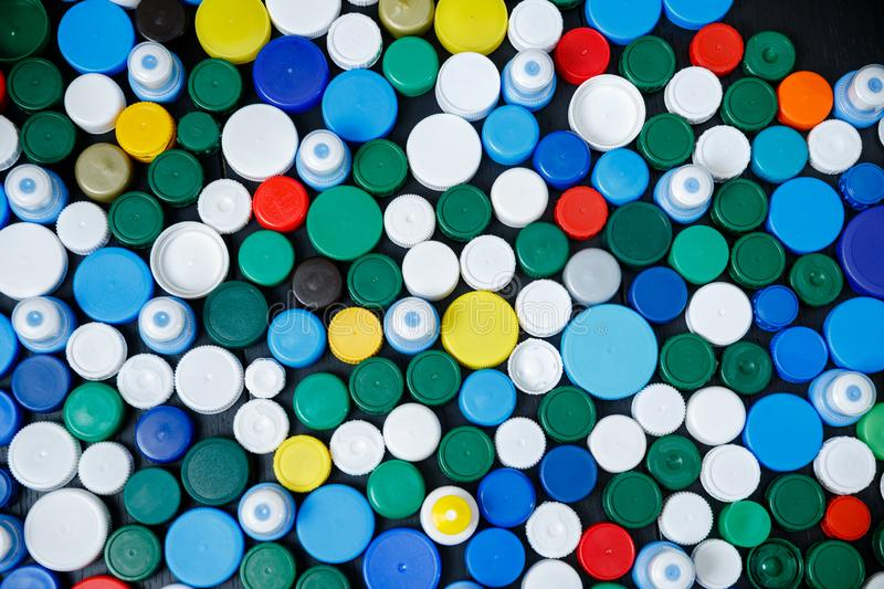 Collection of various colorful plastic caps. Conception of plastic processing for ecology or charity. Collection of various colorful plastic caps. Useful as royalty free stock images