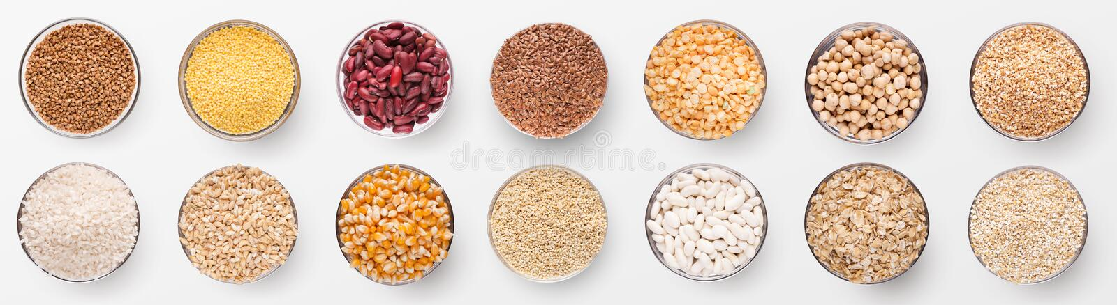 Collection of various grains in bowls isolated on white stock image