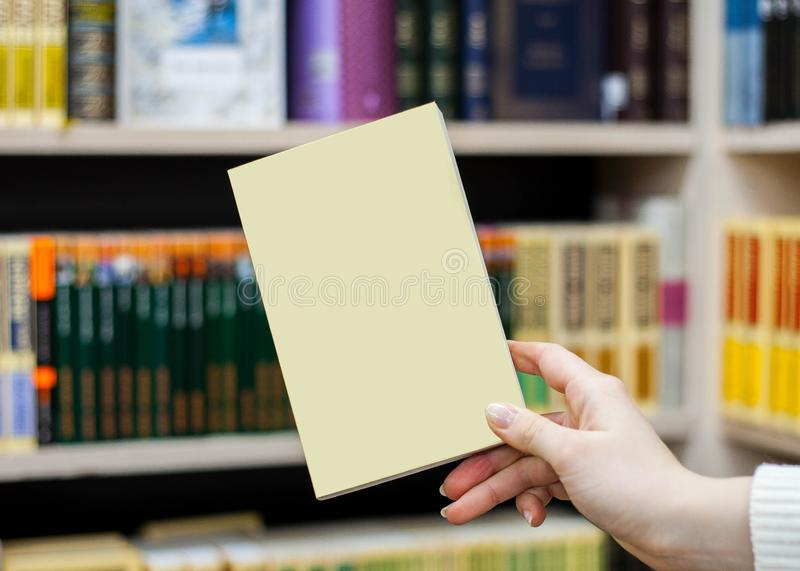 Collection of various white paper on white background. a book under the library royalty free stock images