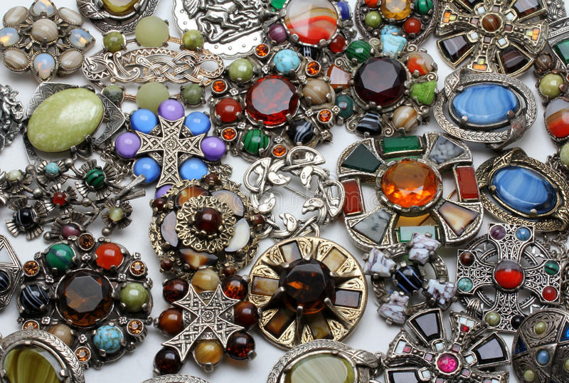 Collection of vintage agate, glass, silver metal celtic styled costume jewellery. Image shows a large multi colored collection of mixed shaped celtic costume royalty free stock photo