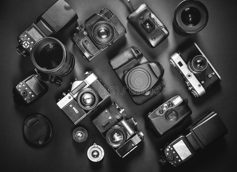 Download collection vintage film and digital cameras on black background top view stock photo