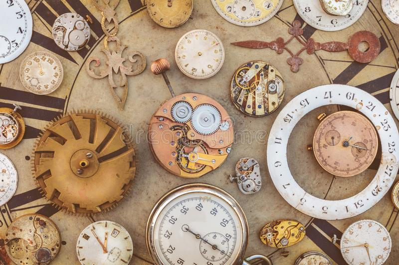 Collection of vintage rusty watches and clock parts royalty free stock images