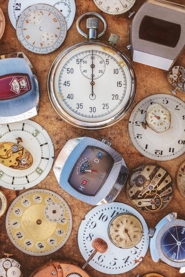 Collection of vintage rusty watches and parts royalty free stock photo