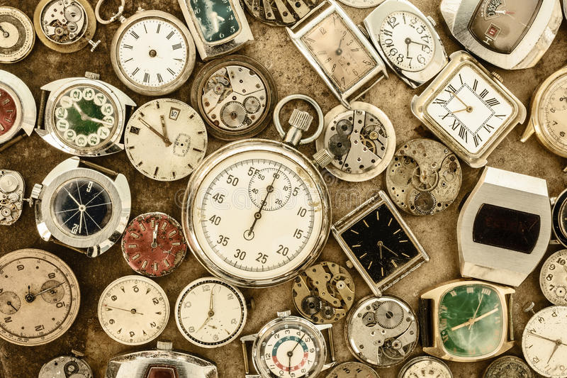 Collection of vintage rusty watches and parts stock photos