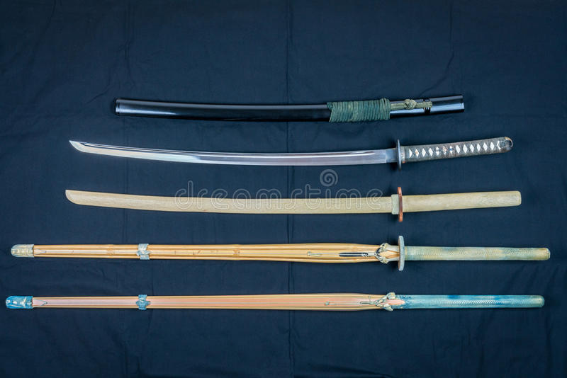 A collection of weapons for training, equipment for Japanese sport Iaido and Kendo. Wood, bamboo and steel sword . stock photos