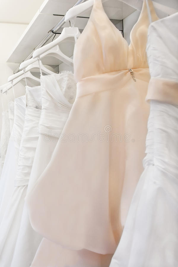 Collection of wedding dresses in the shop stock images