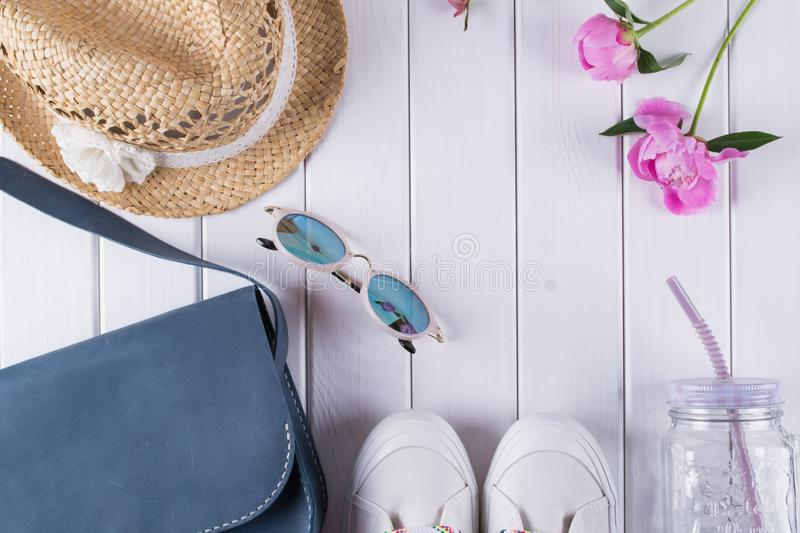 Collection of women`s summer clothes and accessories collage on white, flat lay, royalty free stock photography