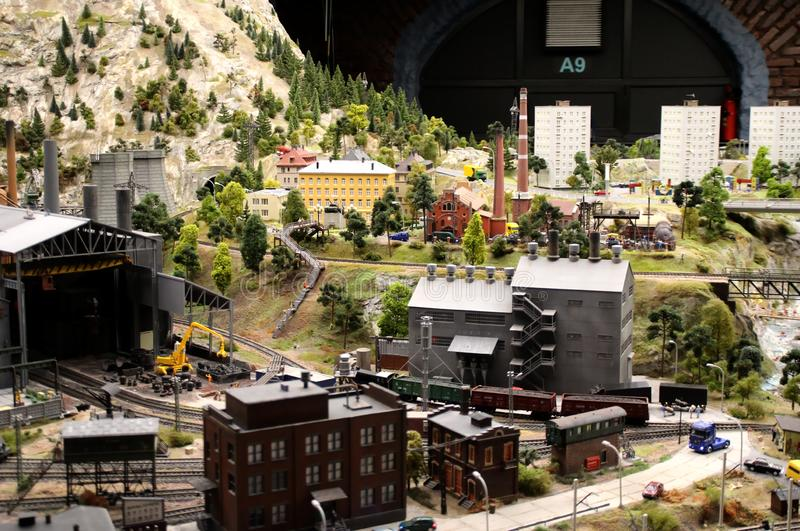 Model of metallurgical enterprise. Collective image of cities and regions of the Russian Federation, made in miniature. National show-museum `Grand layout stock photography