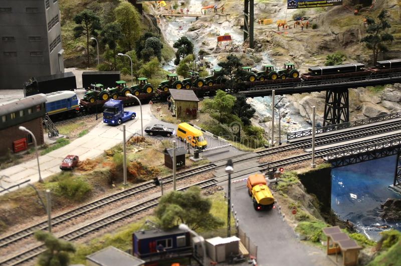 Cars stopped at the barrier at a railway crossing. Collective image of cities and regions of the Russian Federation, made in miniature. National show-museum ` royalty free stock photo