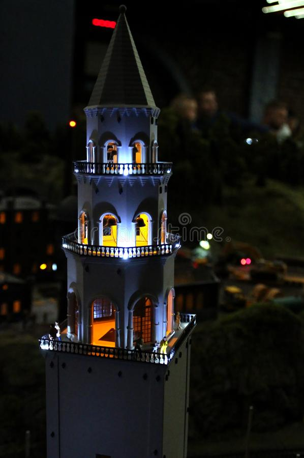Layout of the bell tower in the dark macro shot. Collective image of cities and regions of the Russian Federation, made in miniature. National show-museum ` stock photos