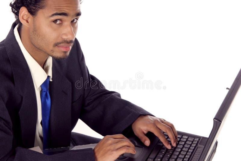 Collega sul suo computer portatile fotografia stock libera da diritti