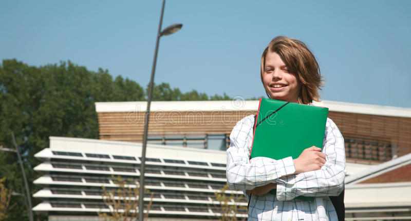 College boy. Young handsome college boy standing front her school stock photo