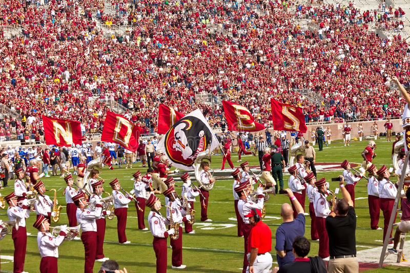 College Football Game. Tallahassee, FL - Oct. 27, 2012: Florida State University's marching band, The Marching Chiefs, takes the field at halftime during a home royalty free stock photos