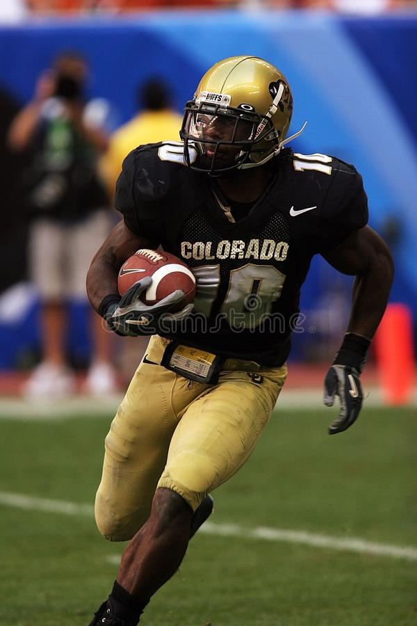 College football player running with ball