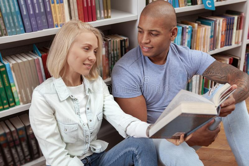 College friends at the library together royalty free stock photos