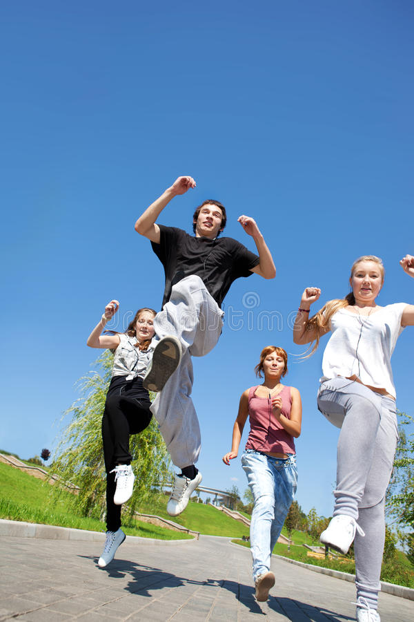 College friends running royalty free stock photos