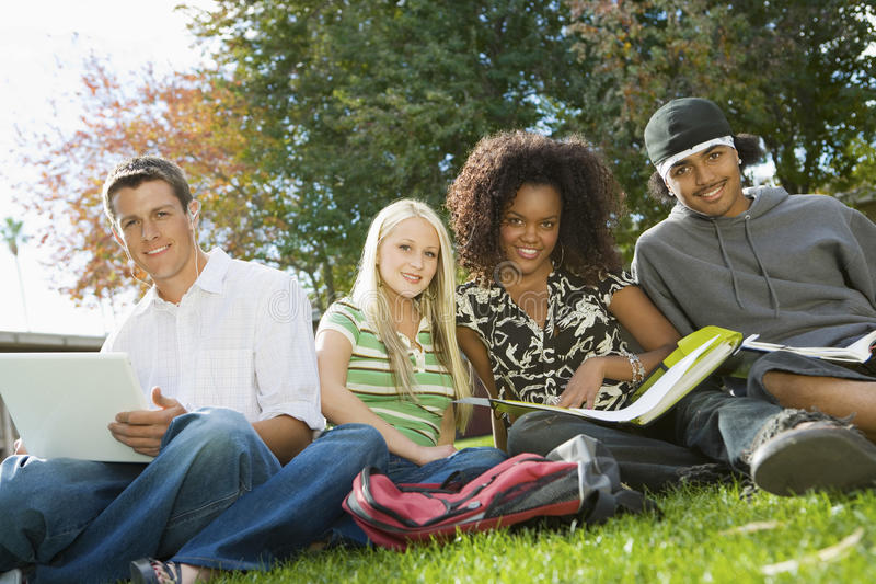 College Friends Studying In Campus royalty free stock image