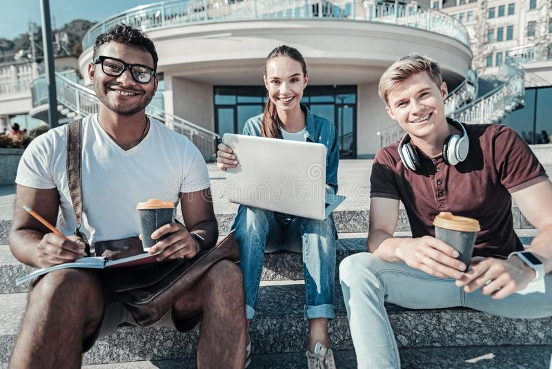 Joyful young students looking at you stock photography