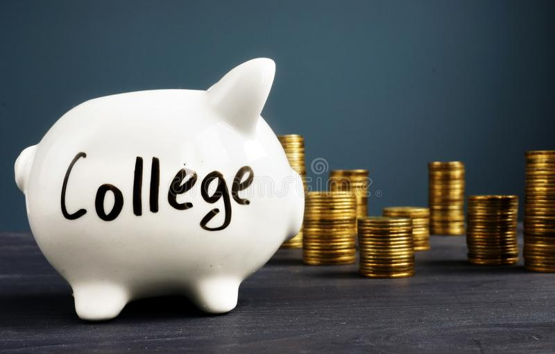 College fund. Piggy bank with coins. Money for education royalty free stock photo