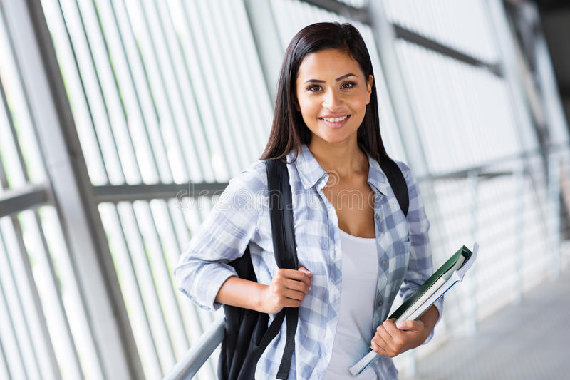 College girl campus. Pretty college girl carrying her books on campus royalty free stock photography