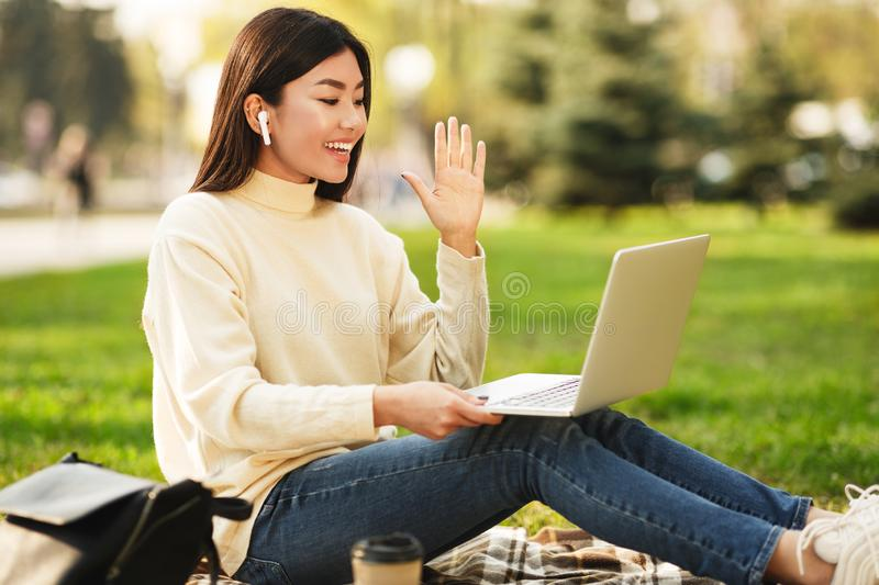 College girl having video call on laptop computer royalty free stock photography