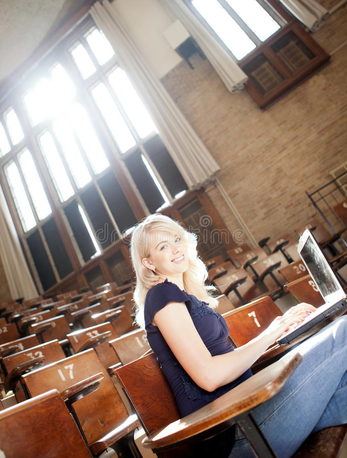 College Girl with Laptop royalty free stock image