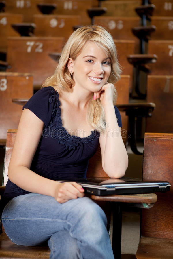 College Girl with Laptop royalty free stock photography