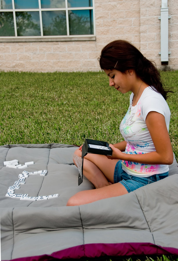 Download A College Girl Playing Domino Stock Photo - Image: 8316592