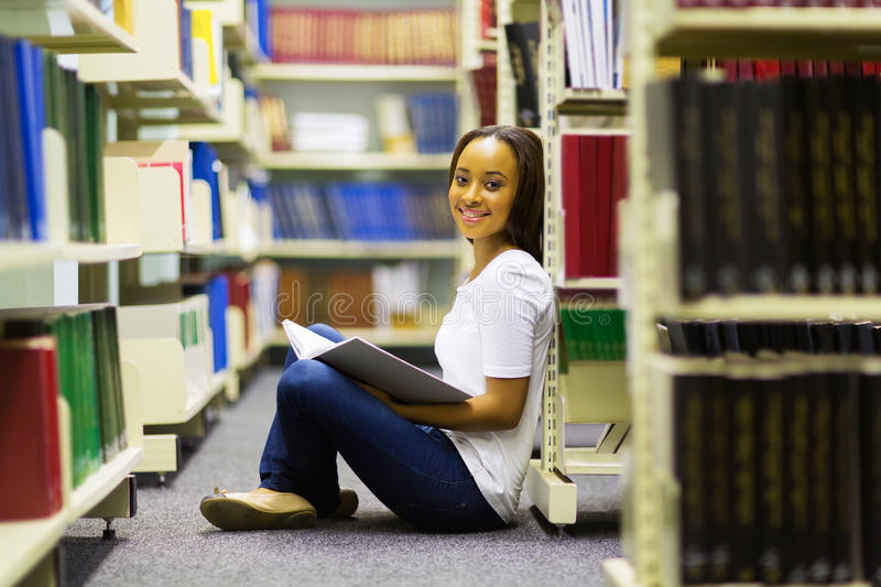 College girl sitting library royalty free stock photography