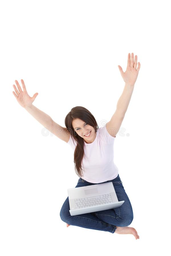 College girl using laptop smiling stock photo