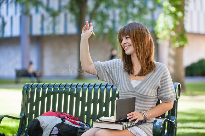 College girl waving hand royalty free stock photo