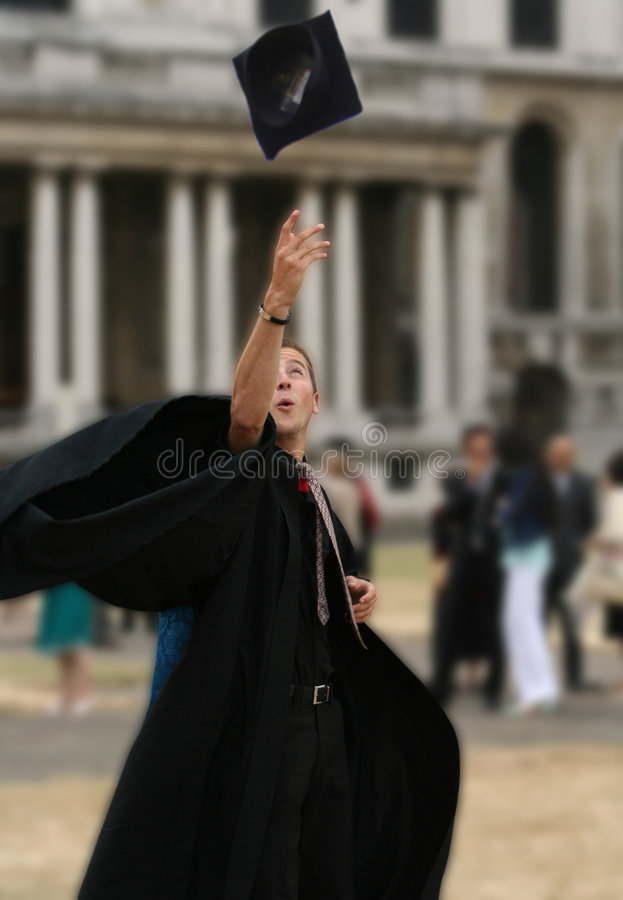 College graduate throwing hat on air