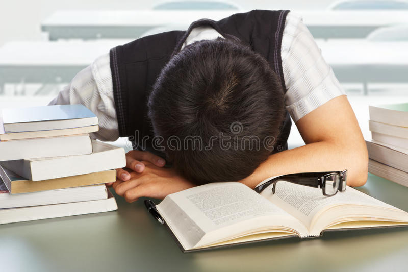 College student fall asleep royalty free stock images